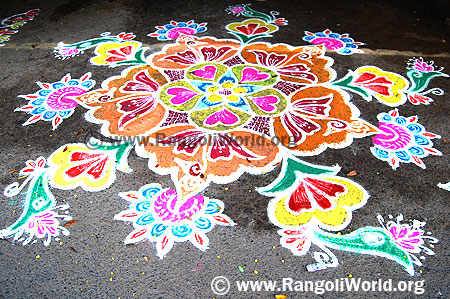 Freehand Rangoli with blooming flowers