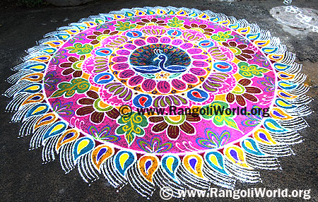 Freehand Rangoli with peacock and lotus flowers